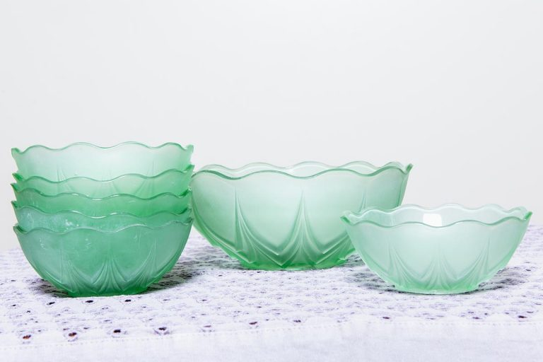 Vintage crockery and prop hire. This is a photograph of a beautiful set of green frosted glass bowls, sourced by Botanical Vintage.