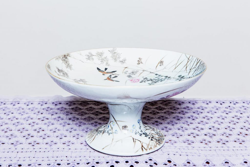 Vintage crockery and prop hire. This is a photograph of a beautifully patterned ceramic cake stand, sourced by Botanical Vintage.