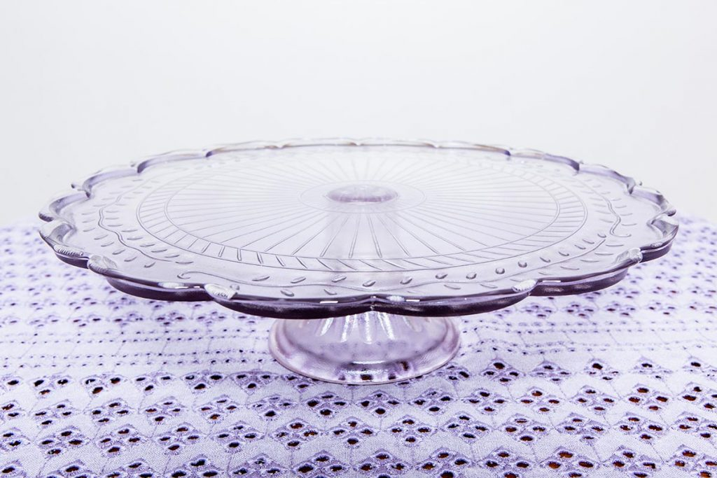Vintage crockery and prop hire. This is a photograph of a beautifully patterned cake stand, sourced by Botanical Vintage.