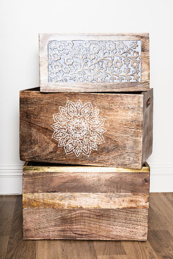 Vintage crockery and prop hire. This is a photograph of a selection of wooden vintage boxes. One of them is hand carved with a delicate floral patterning. sourced by Botanical Vintage.