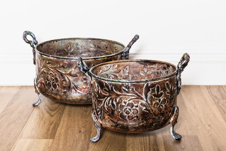 Vintage crockery and prop hire. This is a photograph of two vintage copper planters. They are both adorned with a masterful floral pattern. sourced by Botanical Vintage.