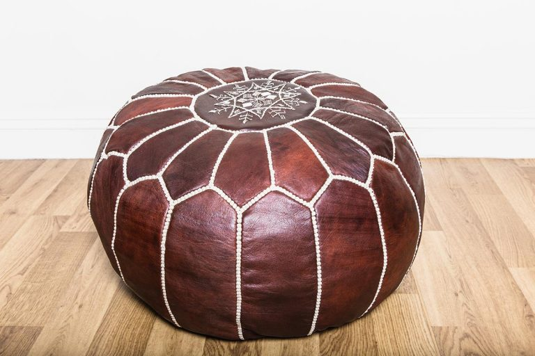 Vintage crockery and prop hire. This is a photograph of a single brown coloured vintage moroccan pouf. It is lavishly segmented with white stitching and on top is an ornate mandala-style design. Sourced by Botanical Vintage.