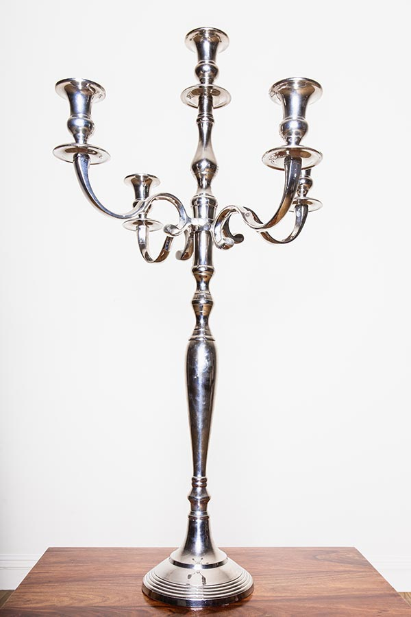 Vintage crockery and prop hire. This is a photograph of a beautiful silver vintage candelabra. sourced by Botanical Vintage.