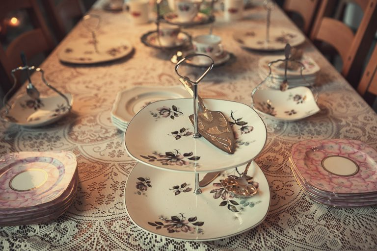 Botanical Vintage Northcourt Manor styled bridal photoshoot 2018. A photograph of the breakfast table. The focus is on a vintage cake-stand. The rest of the table is adorned with various vintage crockery including plates and cups.
