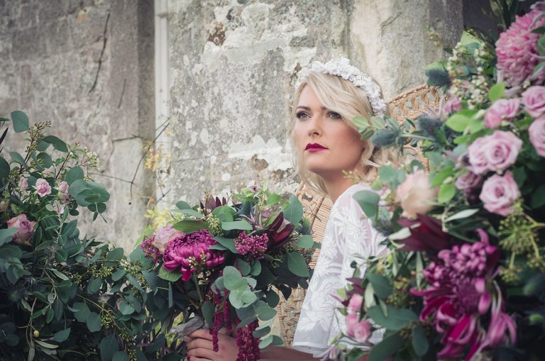 Bohemian Style bride surrounded by flowers