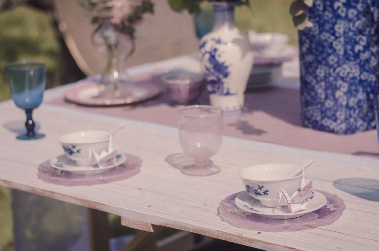 Oriental teacup and saucer with origami bird