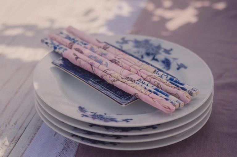 Chopsticks and napkins on oriental china plates