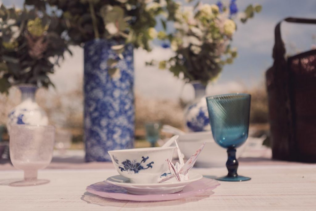 An oriental teapot and origami bird