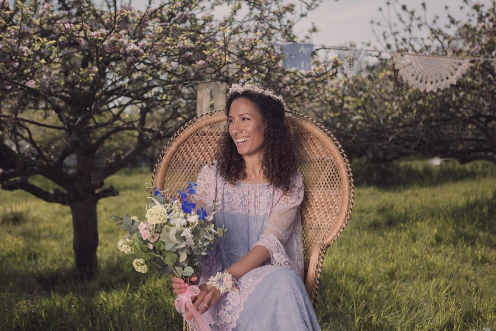 Beautiful bride in the peacock chair