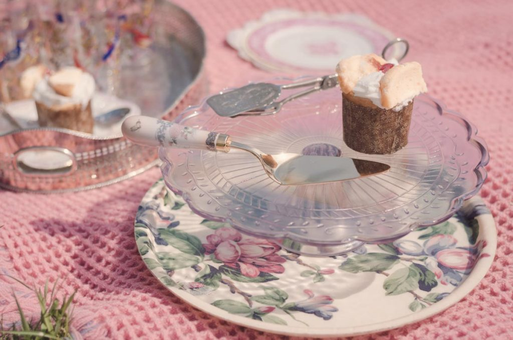 Delicious tiny cupcakes on a cake server