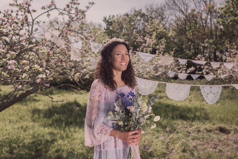 Happy bride with backdrop of dainty bunting