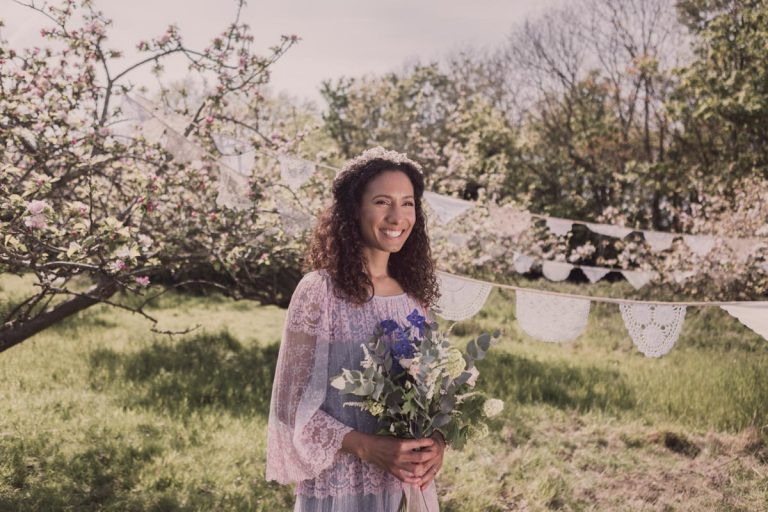 Smiling bride with backdrop of dainty bunting