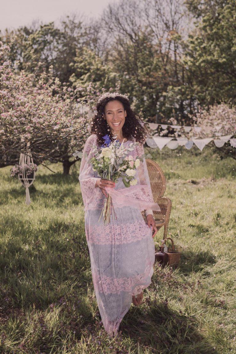 Happy bride amongst confetti