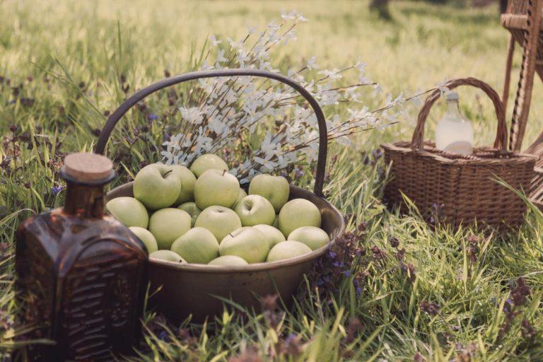 A basket full of fresh green apples