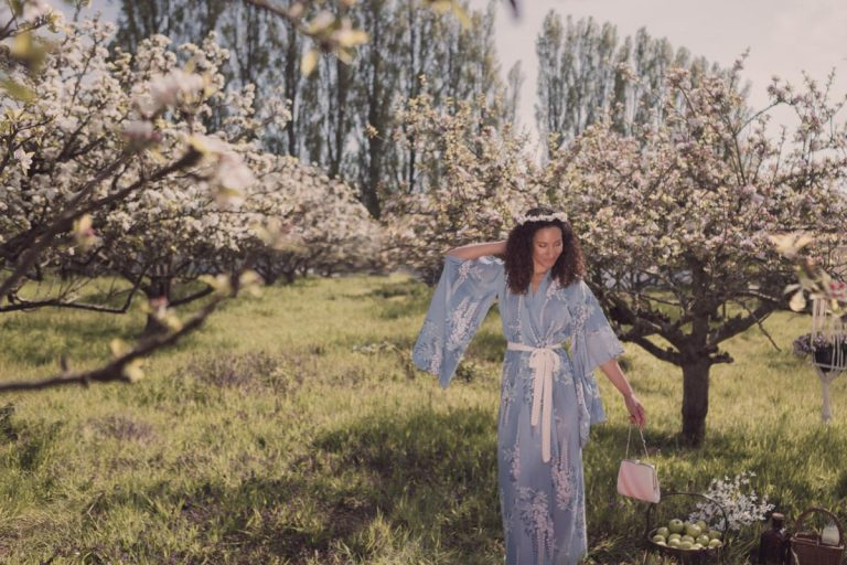 Our model standing delicately amongst the apple trees