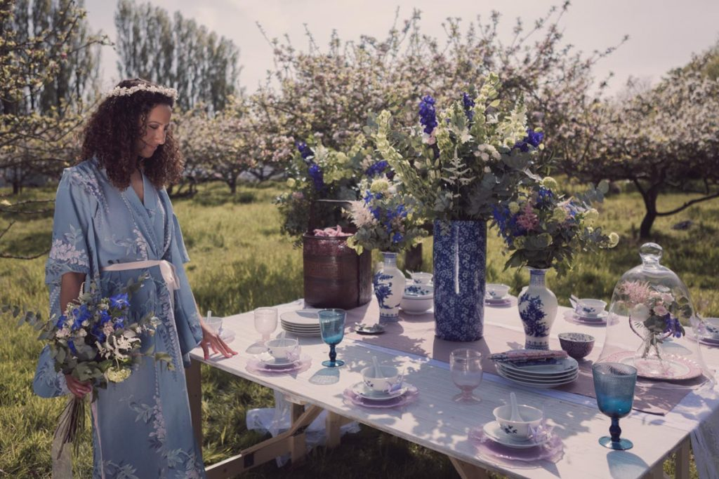 Our model Georgia wearing a kimono standing close to a stunning oriental themed table spread