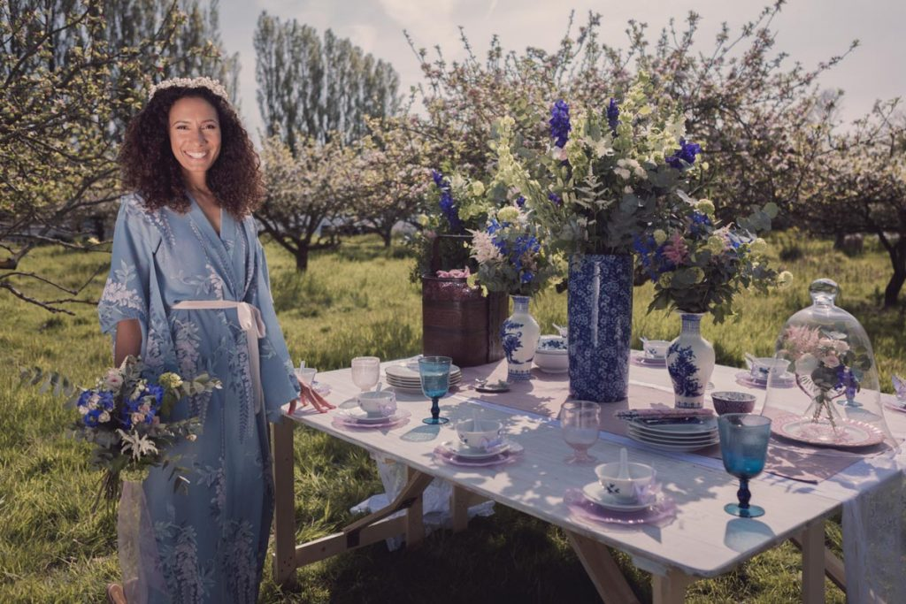 Our model wearing a kimono standing close to a stunning oriental themed table spread