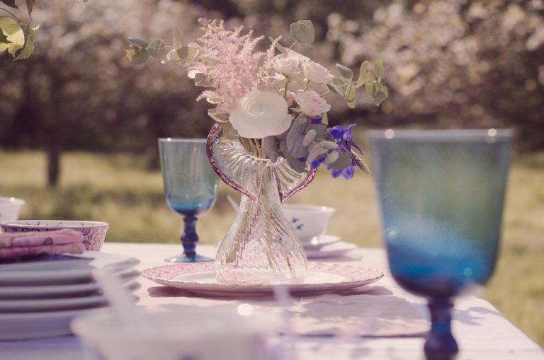 Delicate flowers in a tear drop glass vase