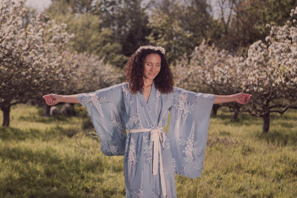 Wearing a kimono, our beautiful model outstretched her hands in the warm spring sunshine