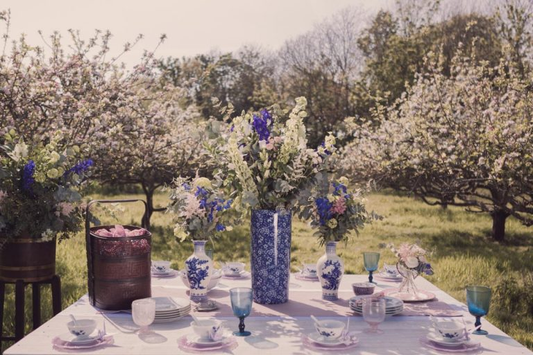Flowers take centre stage upon this beautiful oriental themed table spread within the apple orchard
