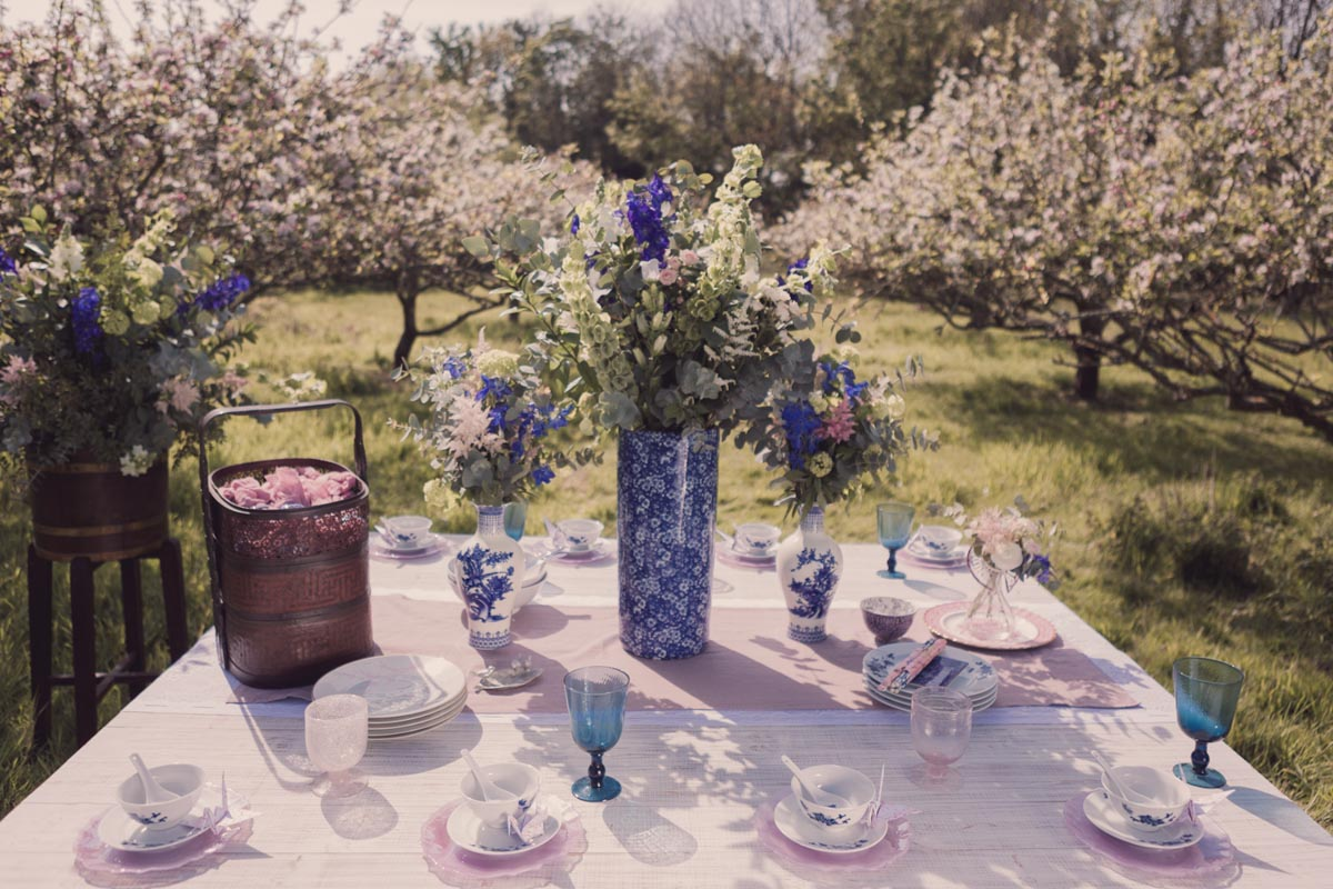 A beautiful oriental themed table spread within the apple orchard
