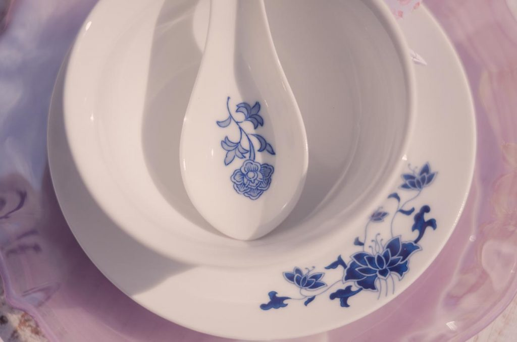 Oriental themed vintage chinaware - a saucer, bowl and spoon