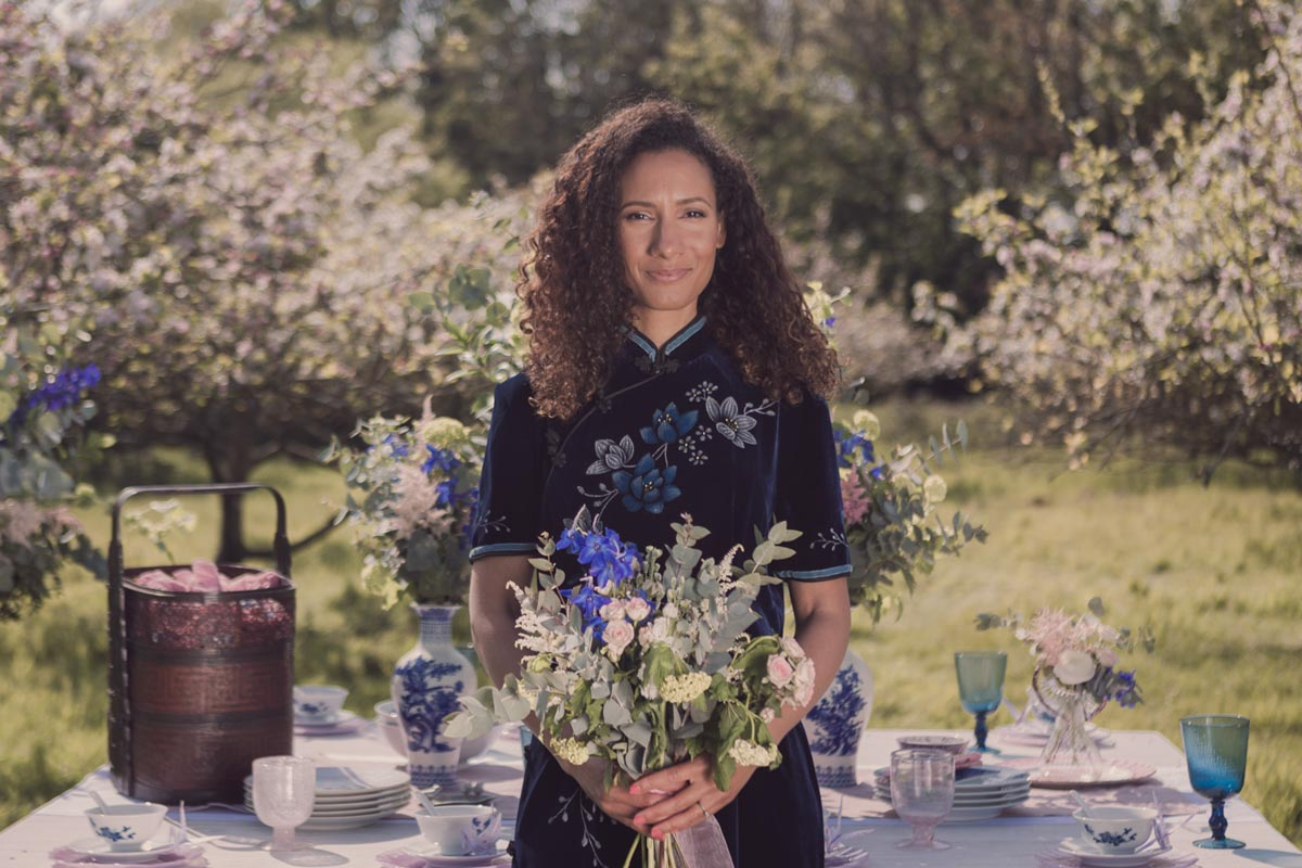 Portrait of our model with wedding bouquet and bathed in warm spring sunshine