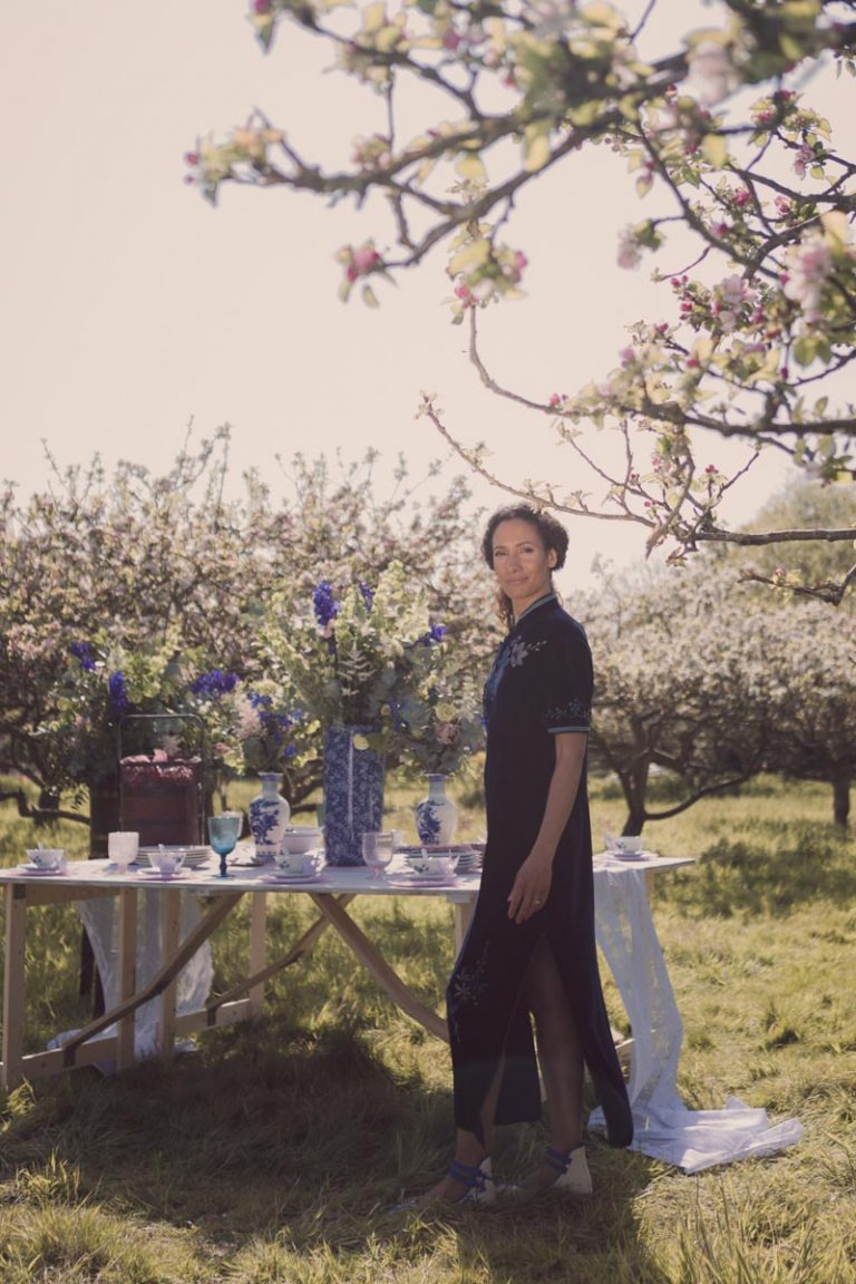 Soft spring sunshine and our model stands in front of an oriental themed table spread