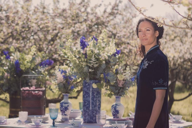 Spring sunshine and our model stands in front of an oriental themed table spread