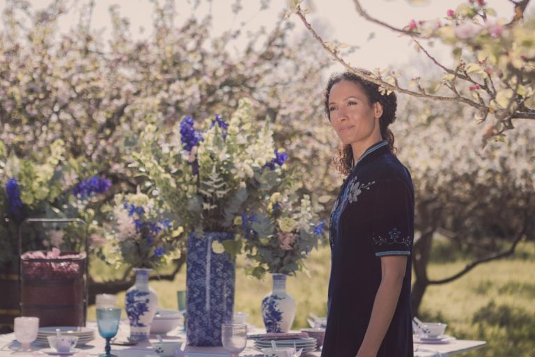 Warm spring sunshine and our model stands in front of an oriental themed table spread