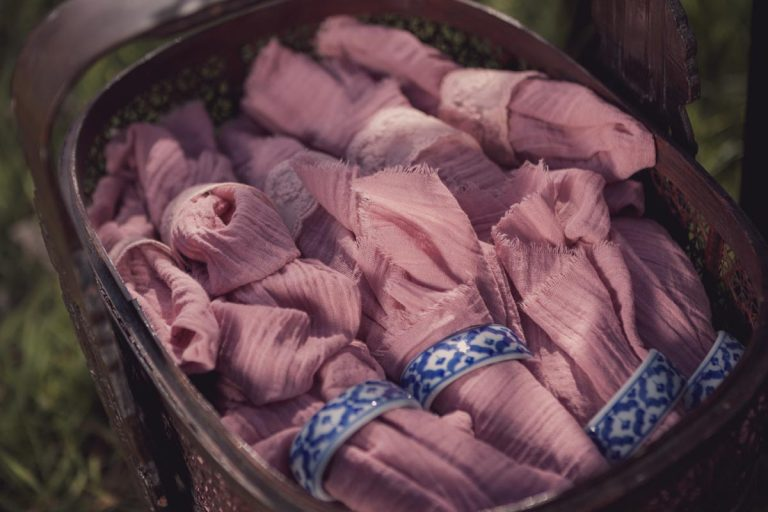 Rolled up napkins in a wicker basket